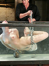 Tiny Tits, Hot sexy girl is tied, gagged, suspended while suffering through water tortures.