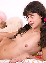 Small Titties, Irresistibly beautiful teen girl gets rid of her clothes just to let you see her spots.