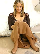 Tiny Boobs, Melanie in a revealing brown top and long brown dress.