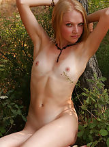 Svelte blonde girl showing natural beauty of her super-b body outdoors