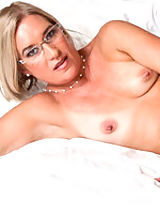 Sexy Suz seduces her son's best friend.